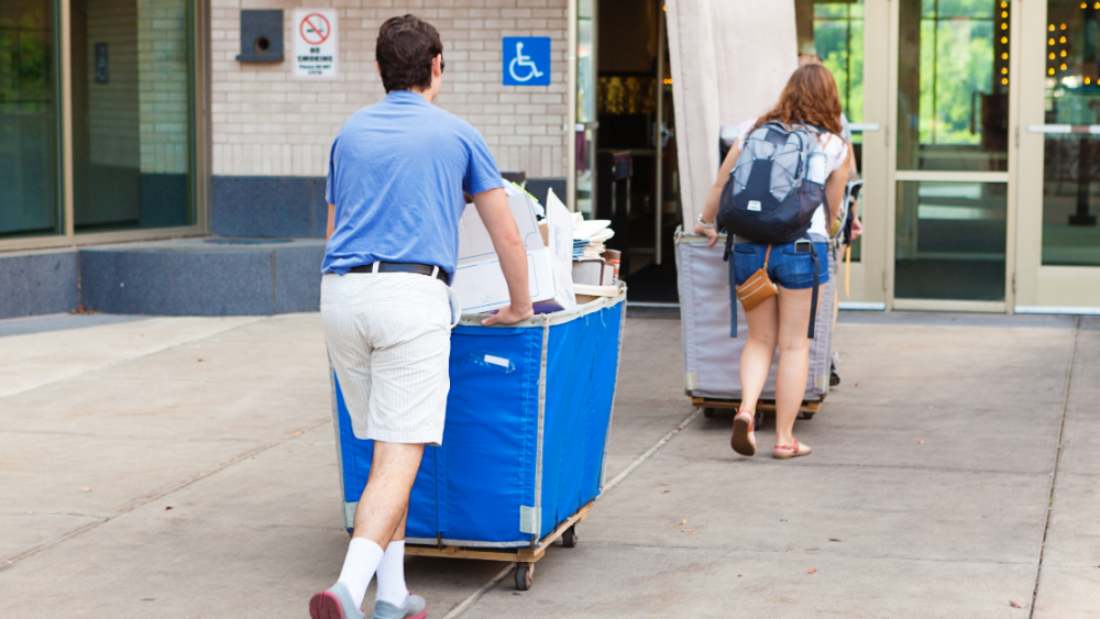 College students moving in with big wheeled bins
