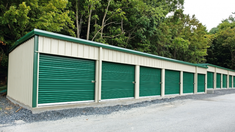 A row of green and tan outdoor storage units